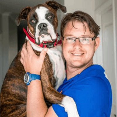 Smiling Man Hugging Dog