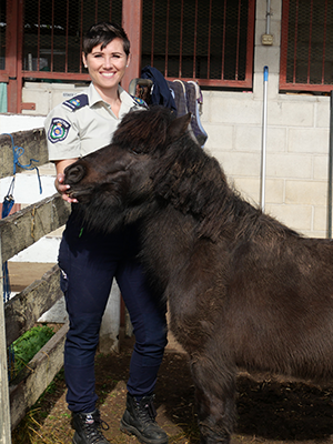 Pony and Woman in Uniform