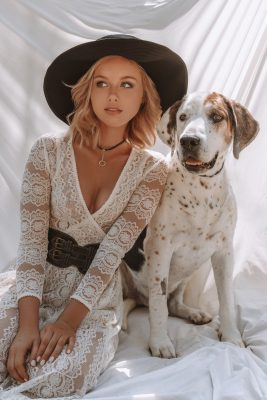 Cute dog posing with blonde lady