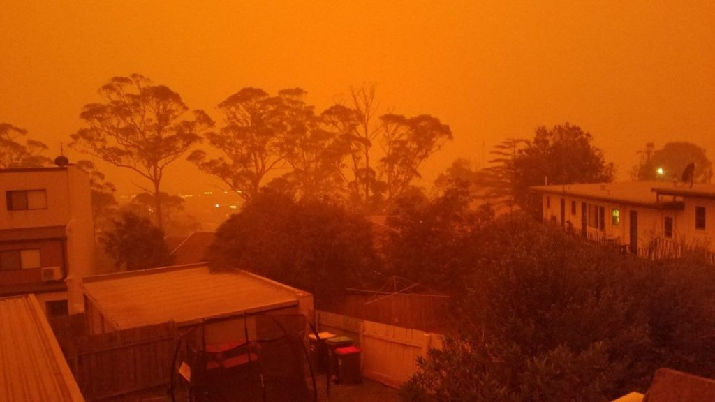 Orange sky at night caused by fires