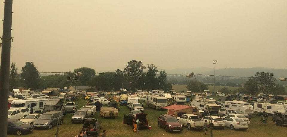 campervans and trailers in a field